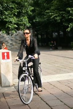 classy looking chic on a bike <3