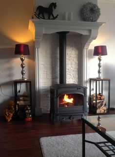High mantle over wood stove. Stove Fireplace, Fireplace Mantels, Fireplaces, Mantles, My Living Room, Home And Living, Wood Stove Decor, Wood Stove Surround, Best Camping Stove