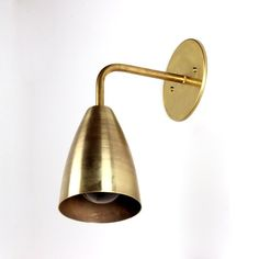 Brass shaded wall sconce