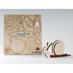 Kids will love this puzzle-like snail toy assembled from the exiting animal collection of Touchwoodesign an in Israel. The plywood sheet includes a snail that comes ready to be mounted and will come to life as you take the pieces out and put them easil Cnc, Laser Cut Plywood, Laser Cutting, 3d Laser Cutter, Wood Crafts, Diy And Crafts, Bent Wood, Scroll Saw Patterns, Metal Fabrication