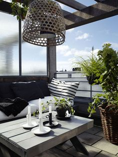 wallstudio: Inspiring Outdoor Spaces - Modern balcony with monochrome black, white and grey [gray] colour scheme. I love the big woven pendant light shade, the bench seat and the stripe pillow