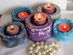Candle holder by Fgasior on Etsy handmade candle holder.made with cement.Acrylic paint,gliter,glue,pearls,stones etc.Please visit my shop on etsy for more detail.Thank you