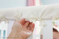 Cut up pieces of fleece to create a teething guard for your baby's crib.