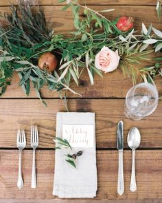 At the reception, farm tables were decorated with pomegranates and their leaves, while an olive branch rested atop each napkin. Get more inspiration from this Kentucky wedding online!