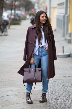 City chic in a burgundy coat and metallic boots.