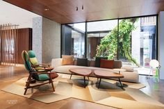 In the lobby lounge at Il Sereno Lago di Como, an Italian hotel by Patricia Urquiola, her seating and side tables stand out against a wall of local breccia stone. Photography by...