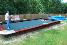 """STRANGE NEW LAWN GAME - HUGE 20 FOOT NO LEGS BILLIARDS TABLE BUILT AND BALLS ARE """"BOWLED"""" INTO POCKETS - EIGHTBALL IN THE SIDE POCKET!"""
