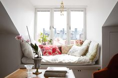 love the little pops of color in the pillows and the flowers