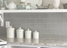 Wall color: Valspar's Tranquil  Floor tile: Lowe's (Giotto Grey)  Granite counters, sink & faucet: Lowe's (Kashmir White granite)  Backsplash: Emser Tile's Lucente in Morning Fog (special order from Lowe's)  Accessories: DIY, Hobby Lobby, ZGallerie, Goodwill, Target, flea markets, etc.  Dinette set: Walmart  Bamboo blinds: Amazon