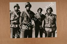 James  Mitchum, George  Hamilton, George  Peppard, and  Eli  Wallach  in  The  Victors.