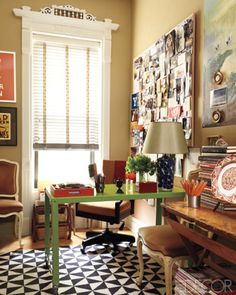 I just love how casual this office is... it makes me believe that I, too, might pull off the studied clutter look...