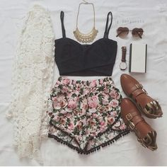 Floral shorts, black crop top, lace kimono, and booties