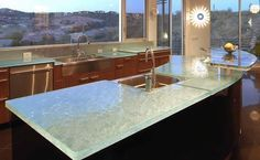The appearance of glass countertops; look at how the lighting travels.