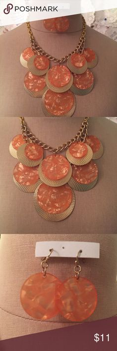 NWT Statement Necklace and Earrings Iridescent salmon colored socks layered over textured gold disks and connected to a thick gold colored chain. This is super fun retro inspired necklace. BRAND NEW. The earrings are in their original packaging, there was no packaging on the necklace and it was a gift so the price tags were removed. From a boutique in Texas. LF Jewelry Necklaces
