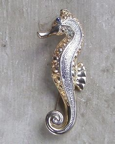 GOLD AND SILVER TONE CRYSTAL SEAHORSE BROOCH