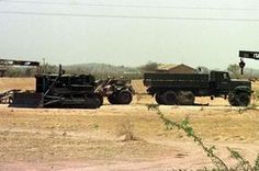 An army truck and a earth-moving equipment sit May 14 at the Pokhran military range in the northwestern Indian state of Rajasthan, near the area where India conducted a controversial series of underground nuclear tests this week. The army has cordoned off a sprawling desert area where India conducted the tests that attracted worldwide criticism and some economic sanctions.