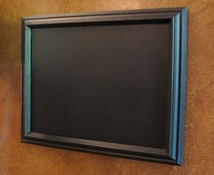 Paint glass in frame with chalkboard paint! Might even try this on my glass desk! Great for kids room!