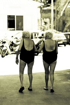 I just love this sweet photo of these twin sisters getting ready for a swim.