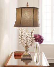 """Lamp features arching """"branches"""" bedecked with glass """"leaves"""" softened by a…"""