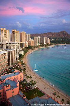 Sunset on Waikiki Beach, Honolulu, Oahu, Hawaii-Waikiki is a neighborhood of Honolulu, in the City and County of Honolulu, on the south shore of the island of Oʻahu, in Hawaii. Waikīkī Beach is the shoreline fronting Waikīkī.  Waikīkī is home to public places including Kapiʻolani Park, Fort de Russy Military Reservation, Kahanamoku Lagoon, Kūhiō Beach Park, and Ala Wai Harbor.