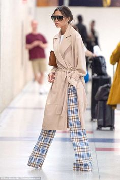 Victoria Beckham arrives solo at JFK Airport in NYC after celebrating Father's Day with hubby David   Daily Mail Online