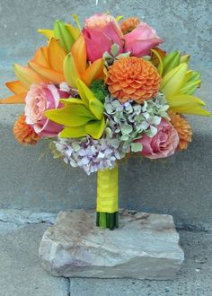 cherry brandy roses, orange dahlias, hydrangea, two colors Asiatic lilies