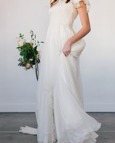 modest wedding dress with flutter sleeves and a flowy skirt from alta moda. -- (modest bridal gown) --