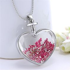 Beautiful dry flower necklace pressed in a heart shape glass. Get close to the nature and feel the beauty of the flower. Nice necklace to wear in any occasions. Buy online at - www.directfromstore.online