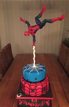 Gravity defying Spider-Man cake by Olivia's Cake Boutique