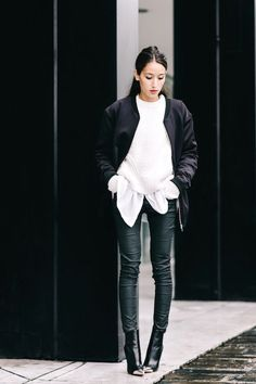 Photos via: Alex's Closet Alex is the epitome of cool in this black and white outfit for fall and winter. To pull off the look, the blogger paired a long black bomber jacket with a chunky white sweate