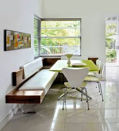 More light to eat by: modern green white wood dining room idea with wooden padded corner banquette bench