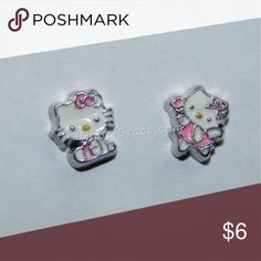2 Hello Kitty Floating Charms Floating Charms go inside the Floating Charm lockets. I have many different charms. floating charms Jewelry