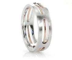 This mens wedding ring features a white gold foundation with a rose gold wire insert in the center.