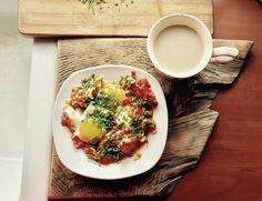 Eggs and tomatoes at the breakfast. Jaja sadzone na pomidorach Tomatoes, Eggs, Breakfast, Ethnic Recipes, Food, Morning Coffee, Eten, Egg, Meals