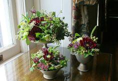 Dahlias, pokeweed, eryngium, roses, hops vine, mint, bupleurum, astrantia and Jasmine vine and joe pye weed.