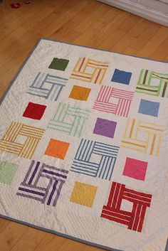 Striped fabric squares quilt.