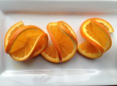 Image from http://www.canadianliving.com/blogs/food/files/2014/03/Double-orange-twist-garnish.jpg.