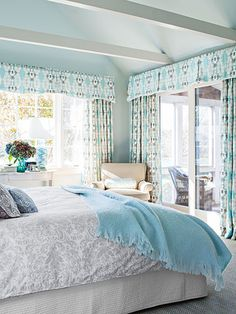 Custom linen drapes frame views of Little Mill Pond in the master bedroom.
