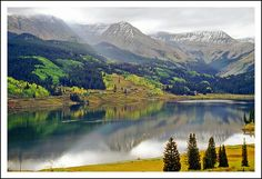 Trout Lake in the Colorado Rockies.  The narrow gauge Rio Grande Southern Railroad ran south through the San Juan Mountains of southwest Colorado from Telluride to Durango. Traveling south from Ophir, the railroad followed a horsehoe shaped loop, along the north shoreline of Trout Lake. CO, USA