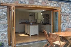 Bi fold doors open onto the patio area