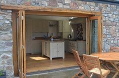 Bi fold doors open onto the patio area