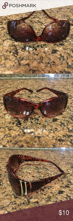 Brownish Black sunglasses Super cute brownish black sunglasses. Gold decoration on both sides. Great for summer!!! 😎 Accessories Sunglasses
