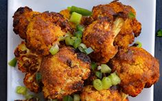<p>Cauliflower is baked (or air-fried) until tender and toasted, and then tossed with curry powder, Sriracha, garlic, and coconut milk to contrast the heat.</p>