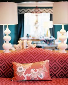 awsome lamps Living Room Photo - A pair of white lamps behind a pink patterned camelback couch