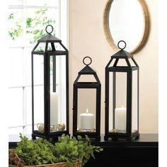 Dramatic style and classic design meets to create a stunning candle lantern that youll love having in your home. This medium-size iron and glass lantern feature