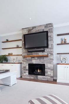 Family room Awesome Dry Stacked Stone Fireplace Ideas - The Urban Interior Home Fireplace, Stacked Stone, Diy Fireplace, Fireplace Design, Living Room With Fireplace, Living Room Designs, Fireplace Remodel, Fireplace Decor, Fireplace Built Ins