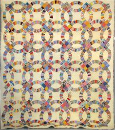 Double Wedding Ring Quilt, good way o use scraps - but this one is too 'square'