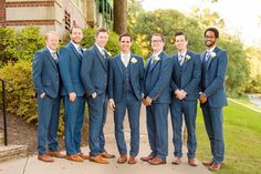 Three-piece wedding suit idea - blue-gray suits with bright buttons {Leeann Marie Photography}