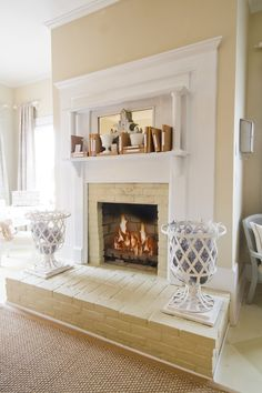 Traditional brick fireplace: Trim out in wood, paint the fireplace the wall color, and paint the trim a neutral but different color.