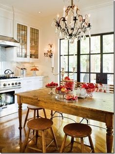 love the chandelier / farmhouse style